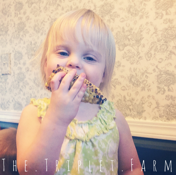 Henley eating corn on the cob in the summertime.